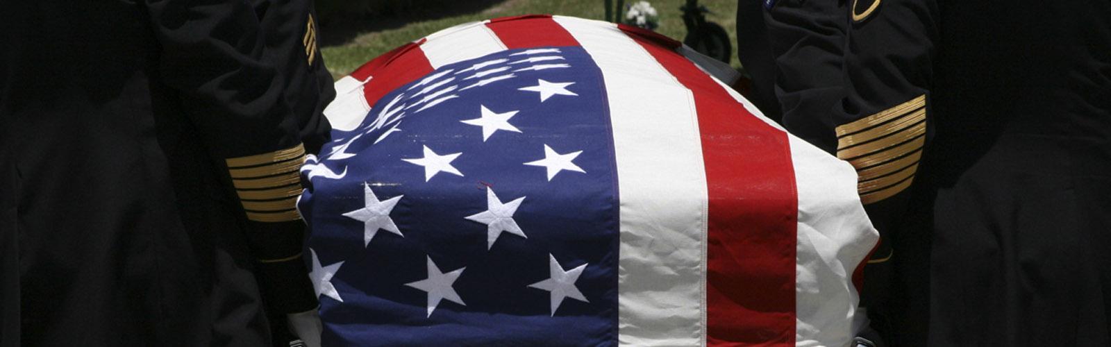 military veteran flag draped coffin